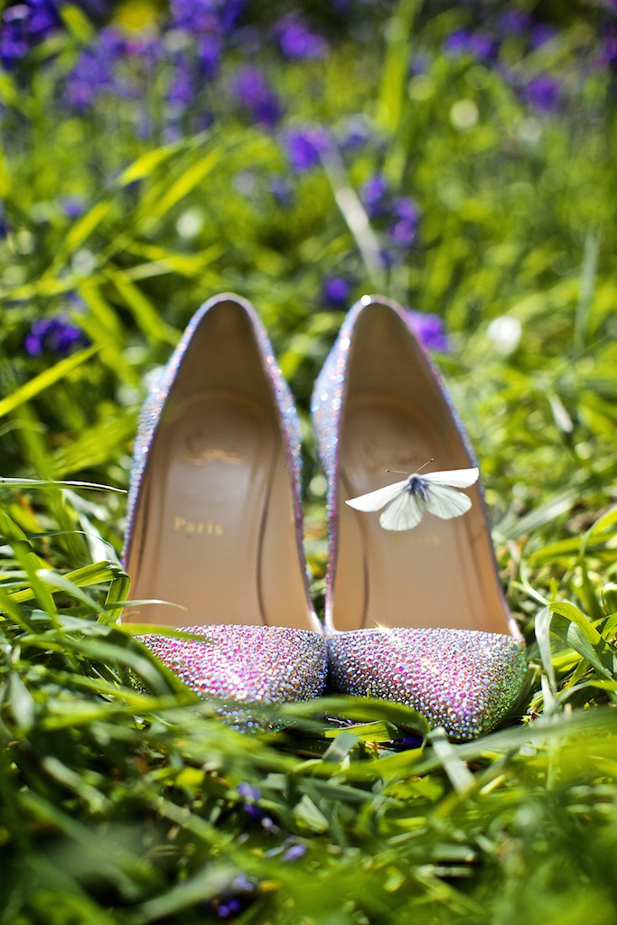 A butterfly over a crystal embellished shoe