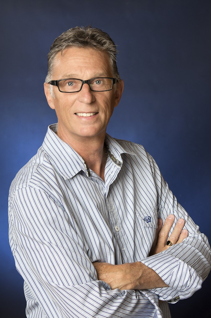 business headshot of a man with a striped shirt